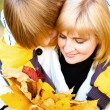 Mother and son in autumn park — Stock Photo