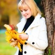Stock Photo: Beautiful young woman in autumn park