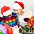 The beautiful family writes  letter to Santa Claus — Stock Photo