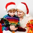Happy family with a gifts — Stock Photo