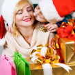 Happy family with a gifts — Stock Photo #8095303