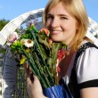The beautiful woman with a bunch of flowers in hands — Stock Photo