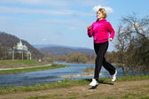 Woman jogging in the park in summer — Stock Photo