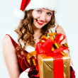 Beautiful woman in a red dress and hat of Santa with a big gift - Lizenzfreies Foto