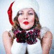 Beautiful miss Santa looking at the snow - Lizenzfreies Foto
