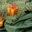 Christmas gift box on green background — Stok fotoğraf