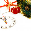 Decoration with a clock and christmas gifts — Stockfoto