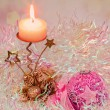 Christmas candle and ball on light background — Stock Photo