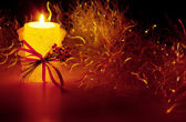Christmas decorations and candles — Stock Photo