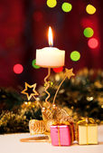 Christmas candle and gift boxes. — Stock Photo