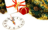 Decoration with a clock and christmas gifts — Photo