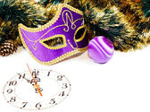 Decoration with a clock, christmas balls and Venetian mask — Photo