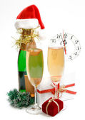 New Year composition with gifts, clock and champagne — Stok fotoğraf
