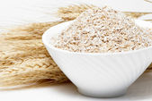 Porridge and Wheat ears on a white background — Stock Photo