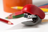 Red stapler and colour pencils On a white background — Stock Photo
