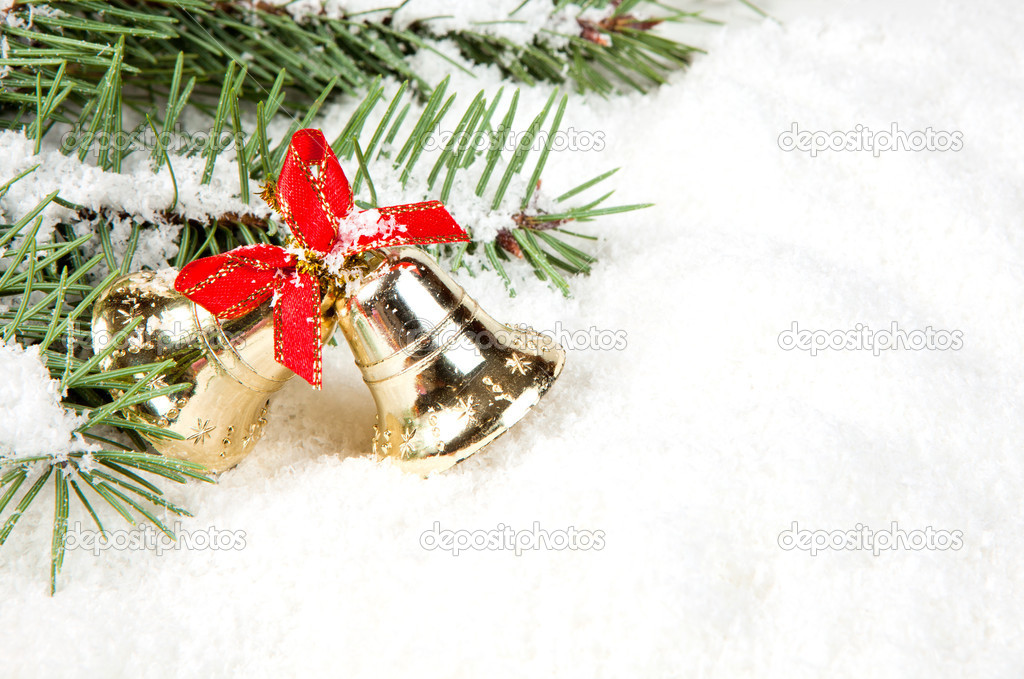 Branch of Christmas tree with bells golden — Foto de Stock   #8135488