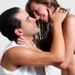 Stock Photo: Intimate young couple during foreplay on a light background