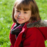 Cute girl in park portrait — Stock Photo
