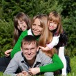 Happy parents and daughters in park — Stock Photo #9499048