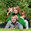 Happy parents and daughters in park — Stock Photo