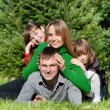 Happy parents and daughters in park — Stock Photo #9499049