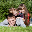 Stock Photo: Happy father and daughters in park