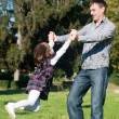 Father and daughter having a good time outdoor — Stock Photo