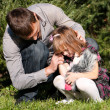 The crying little girl with the father in park — Stock Photo