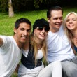 Happy group of friends smiling outdoors in a park — Stock Photo
