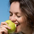 The girl with an green apple — Stock Photo #9501235