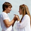 Young couple against the sky — Stock Photo