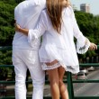 Loving couple standing and hugging against in city. — Stock Photo #9501578
