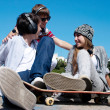 Teenagers Sitting by a street — Stock Photo #9502043