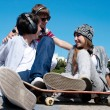 Teenagers Sitting by a street — Stock Photo