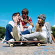 Teenagers Sitting by a street — Stock Photo #9502047