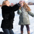 Mother and daughter enjoying beautiful winter day — Stock Photo #9502850