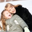 Mother and daughter enjoying beautiful winter day — Stock Photo