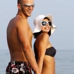 Happy couple in sea — Stock Photo