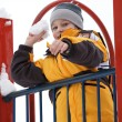 The boy playing snowballs on a children's playground — Stock Photo #9505784