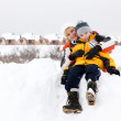 Young mother and her son enjoying beautiful winter day outdoors — Stock Photo