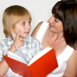 Royalty-Free Stock Photo: Mother with the son reading the book