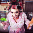 Crazy housewife in an interior of the kitchen — Stock Photo