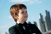 The small gentleman against a city — Stock Photo