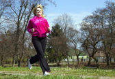 Woman jogging in the park — Stock Photo