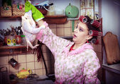 The silly housewife with carcass of a hen in hands — Stock Photo