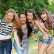 Happy group of friends smiling outdoors — Stock Photo