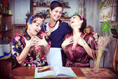 Portrait of three cheerful housewives — Stock Photo