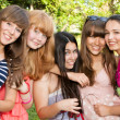 Portrait happy young and attractive girlfriends — Stock Photo
