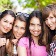 Young and attractive girlfriends have fun in park — Stock Photo