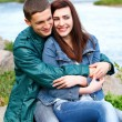Portrait happy young teenage couple outdoor — Stock Photo #9521745